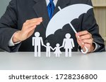 Small photo of Family life insurance, financial security concept : Businessman protects family members e.g parents and two child, depicts protection from insurer, they will pay a lump sum for clearing burden of debt