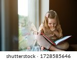 Little girl is reading a book...