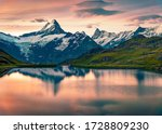 Breathtaking summer sunrise on Bachalpsee lake with Schreckhorn and Wetterhorn peaks on background. Astonishing morning scene in the Swiss Bernese Alps, Switzerland, Europe.  - stock photo