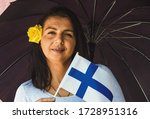 Woman With Umbrella Holds Flag ...