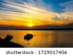 Sunset River Boat Silhouette...