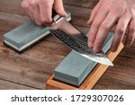 Man Sharpens A Gyuto Knife...