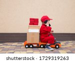 4 Year Old Boy In Red Overalls...