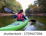Closeup Woman Rowing In A Green ...