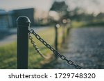 black fence with chains and... | Shutterstock . vector #1729748320