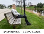 woman sitting on a bench alone... | Shutterstock . vector #1729766206