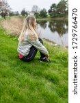woman girl sitting on a grass... | Shutterstock . vector #1729766470