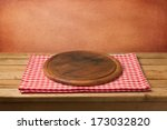 empty wooden table with cutting ... | Shutterstock . vector #173032820