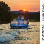 Small photo of Rogue River, Oregon - 8/5/2014: Tourists on a Jet Boat ride at sunset on the Rogue River