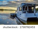 Sunset Behind Houseboat On Lake ...