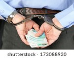 Man's Hands In Handcuffs And...