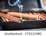 Closeup Of Burning Cigar On...