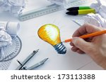 designer drawing a light bulb ... | Shutterstock . vector #173113388