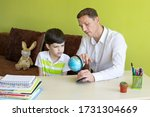 boy with father doing homework... | Shutterstock . vector #1731304669