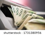 Banknote Counter Machine With Stack Of One Hundred Zloty Of Polish Currency.  - stock photo