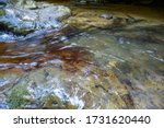 A Mountain River Stream Flows...
