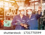 Small photo of Engineer teamwork worker wearing disposable face mask or face shield during working in factory to prevent Covid-19 virus air dust pollution and for good hygiene.
