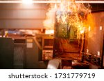 Small photo of Electricity breaker overload short circuit, Old grunge messy fuse box fire burn over heat.