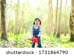 Kids Gardener Holding Water Ca...