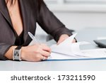 person's hand signing an... | Shutterstock . vector #173211590