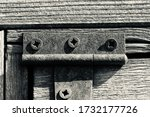 Old And Rusty Hinge With Screws