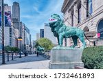 Small photo of Chicago, Illinois / USA - May 2, 2020: The Lions of the art Institute are adorned with surgical masks imprinted with the Chicago city flag because of the Corona virus pandemic of covid-19.