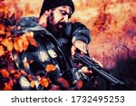 Hunter with shotgun gun on hunt. Autumn hunting season. Closed and open hunting season. Poacher in the Forest. Mountain hunting - stock photo