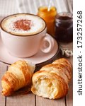 Fresh croissant and cup of coffee for breakfast. - stock photo