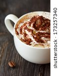 Cup of cappuccino coffee with whipped cream and chocolate close-up. - stock photo