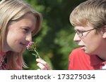 attractive couple in park... | Shutterstock . vector #173275034