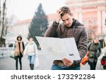 lost tourist looking at city... | Shutterstock . vector #173292284