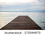 desolate wooden sea dock in dawn | Shutterstock . vector #173344973