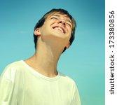 toned photo of happy teenager... | Shutterstock . vector #173380856