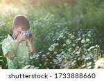 Child With Professional Camera...