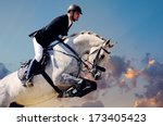 rider on white horse in jump on ... | Shutterstock . vector #173405423