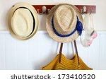Straw hats, beach bag and swimming glasses vacation essentials - stock photo