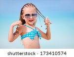 Adorable little girl with Caribbean braids on vacation - stock photo