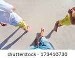 Father and two kids walking together at beach - stock photo