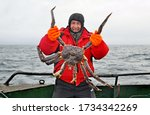 Happy Fisherman In A Red Jacket ...