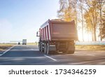 Small photo of A 40 ton truck carries construction sand on the highway. Concept of overload on the roads and rental of a dump truck for work, copy space