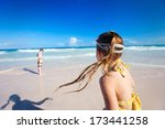 Happy kids running and jumping at shallow water - stock photo