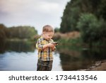 The Boy Is Fishing. Photo Take...