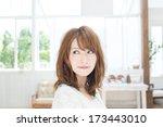 beautiful young woman relaxing... | Shutterstock . vector #173443010
