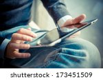 close up hands multitasking man ... | Shutterstock . vector #173451509