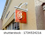 Small photo of Orlando, Florida, USA- February 24, 2020: Tory Burch hanging sign outside the store in Orlando, Florida, USA. Tory Burch LLC is an American fashion label.