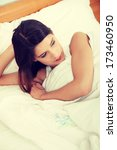 young pretty girl lying in bed. ... | Shutterstock . vector #173460950