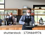 Waiter In A Medical Protective...