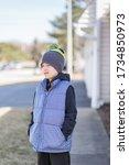 portrait of a boy wearing vest... | Shutterstock . vector #1734850973