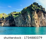 Steep Grassy Cliffs Meet The...