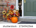 Pumpkin By The Doorstep Of A...